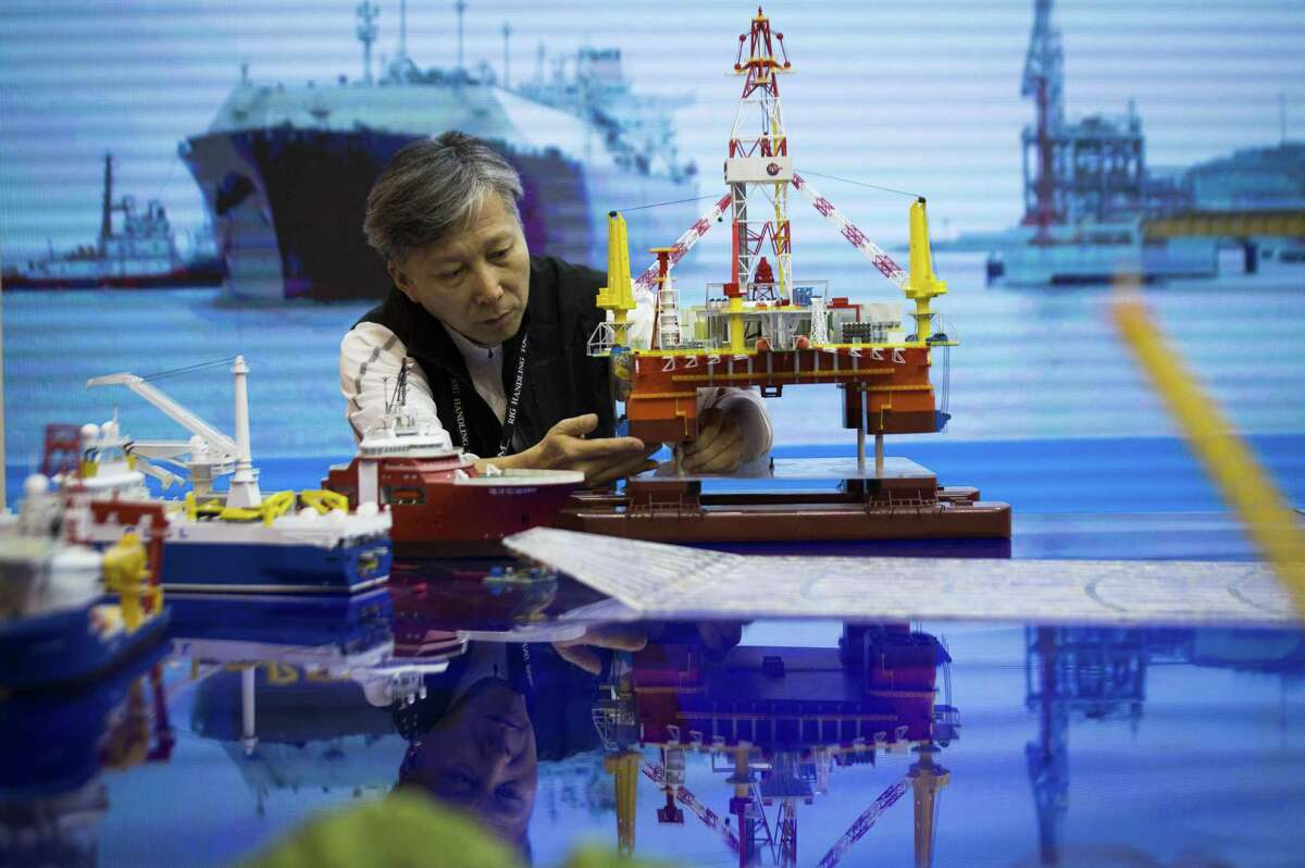 Lin Duosen of the China National Offshore Oil Corporation prepares a model to be transported on the last day of Offshore Technology Conference 2018, Thursday, May 3, 2018, in Houston. ( Marie D. De Jesus / Houston Chronicle )