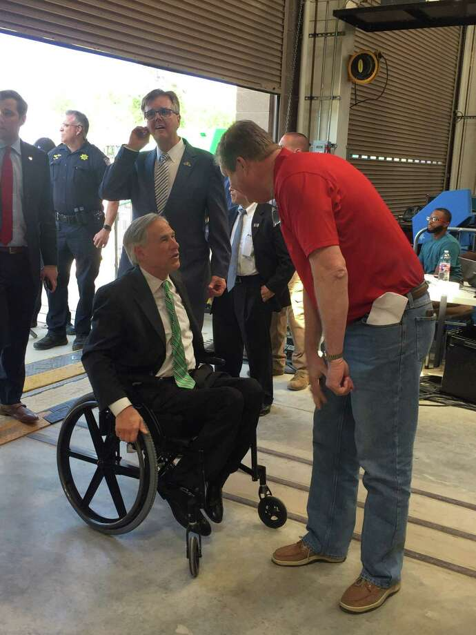 Scott Stephens (in the red shirt) helped welcome multiple top Texas officials, including Governor Greg Abbott, for President Donald Trump's speech at the IUOE Training Center in Crosby on April 10. Photo: Greg Poole