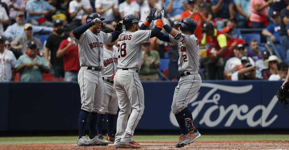 Teammates celebrate a grand slam by Houston Astros' Alex Bregman, right, in the fifth inning of a baseball game against the Los Angeles Angels, in Monterrey, Mexico, Sunday, May 5, 2019. (AP Photo/Rebecca Blackwell)