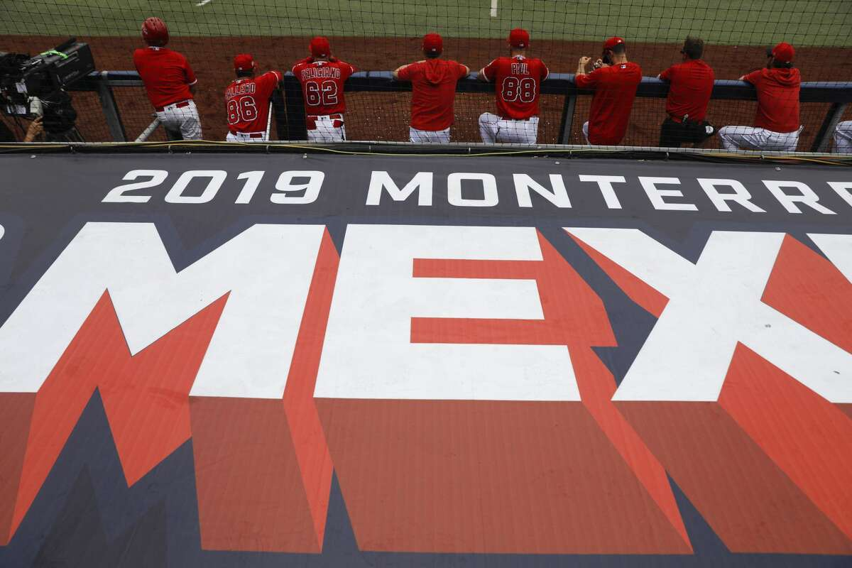 Los Angeles Angels' players look on from the dugout during the second inning of a baseball game against the Houston Astros, in Monterrey, Mexico, Sunday, May 5, 2019. (AP Photo/Rebecca Blackwell)