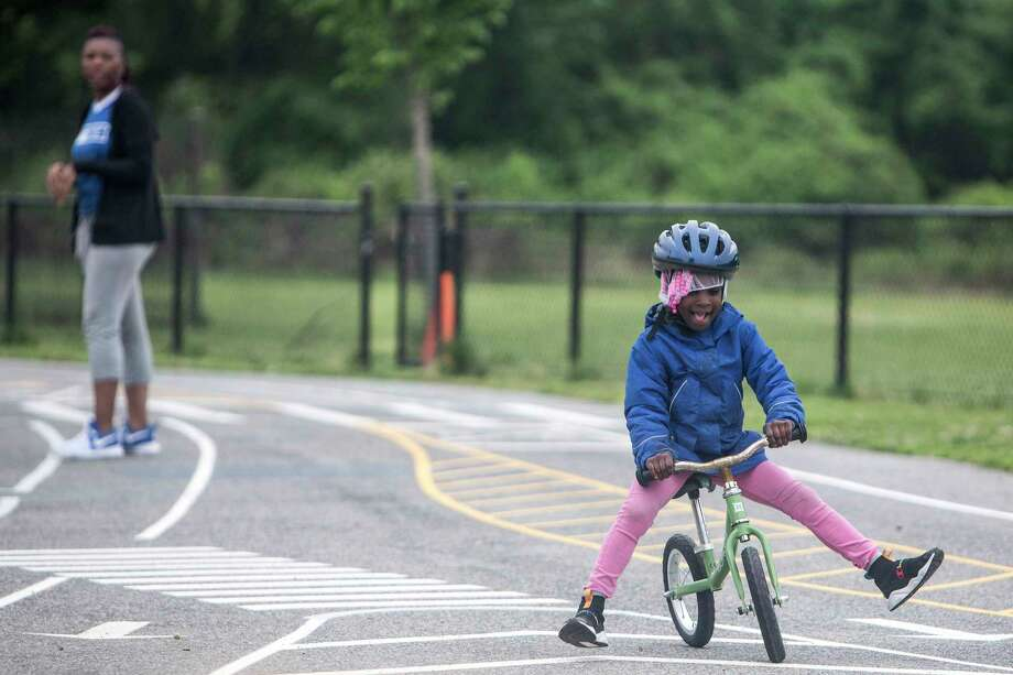 Payton Davis tries to stay in the right lane during a traffic safety lesson at Neval Thomas Elementary School in Washington on Wednesday, May 1, 2019. Photo: Photo For The Washington Post By Jay Westcott. / Jay Westcott