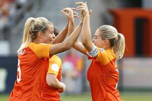 Houston Dash forward Rachel Daly (3) and forward Kealia Ohai (7) celebrate Ohai's goal against the Orlando Pride during the first half of a National Women's Soccer League match at BBVA Compass Stadium on Sunday, May 5, 2019, in Houston.