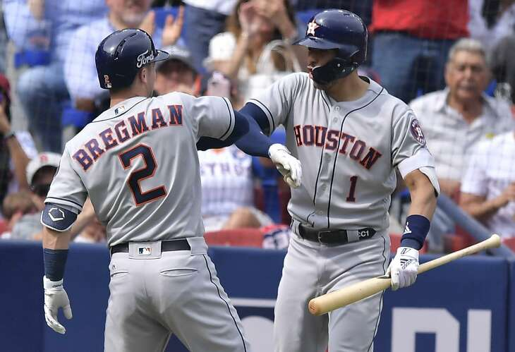 Alex Bregman celebrates his fifth-inning grand slam with Carlos Correa, who hit a two-run homer in the Astros' 10-4 victory over the Angels on Sunday at Estadio de Beisbol Monterrey.
