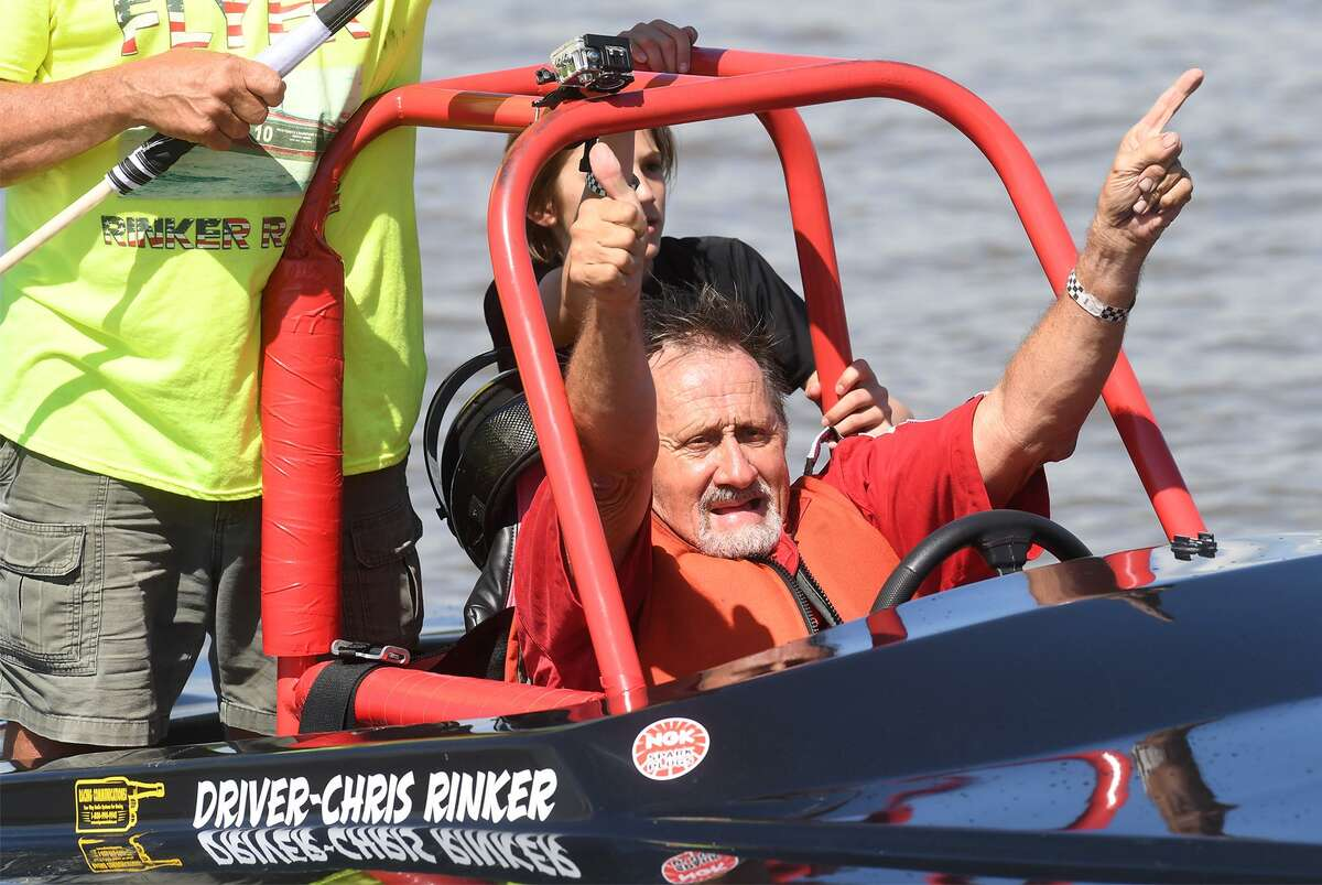 Chris Rinker celebrates after winning the tri-hull boat races at Port Neches' Thunder on the Neches Sunday. Photo taken Sunday, 5/5/19