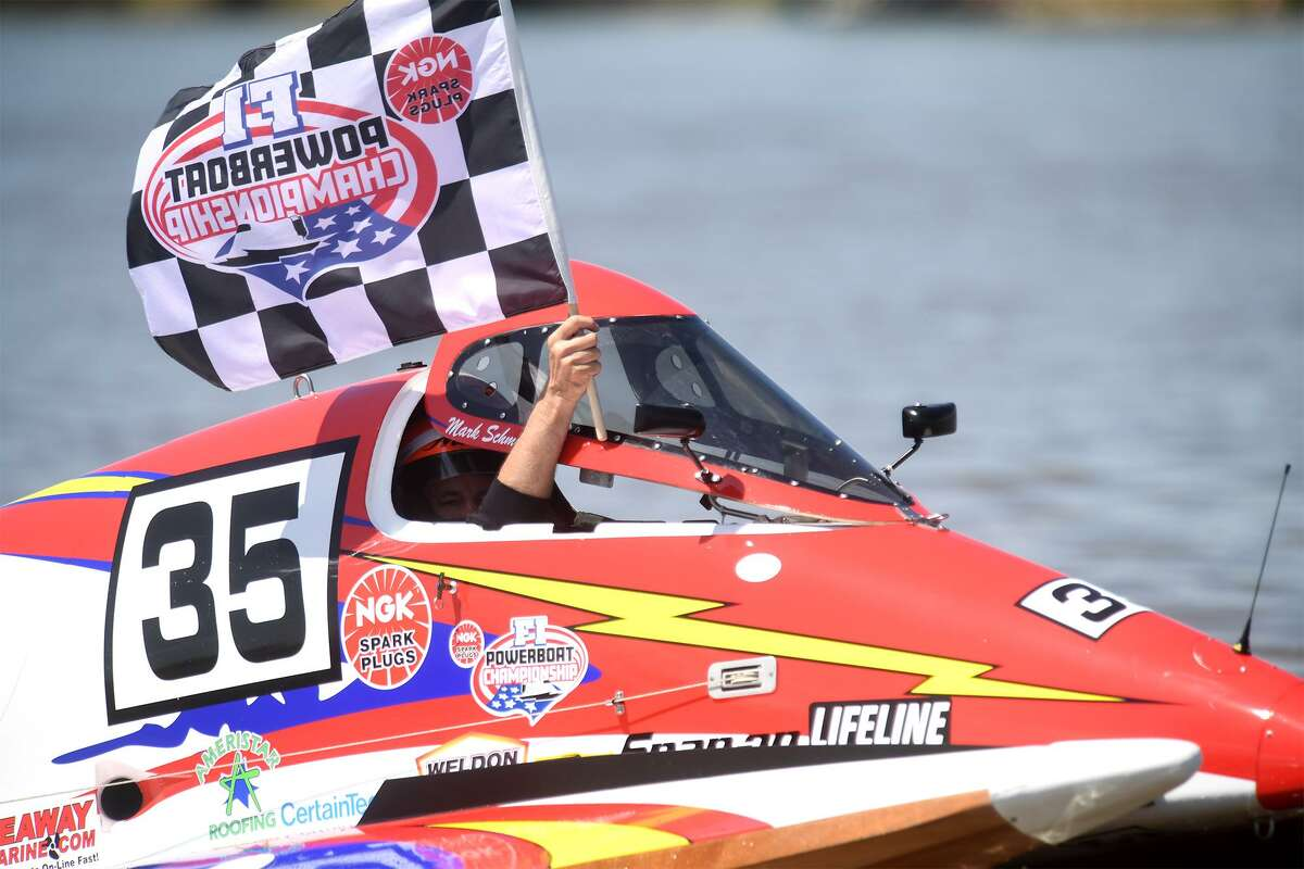 Formula light boat racer Mark Schmerbauch runs a lap with the checkered flag after winning first place at Thunder on the Neches in Port Neches. Photo taken Sunday, 5/5/19