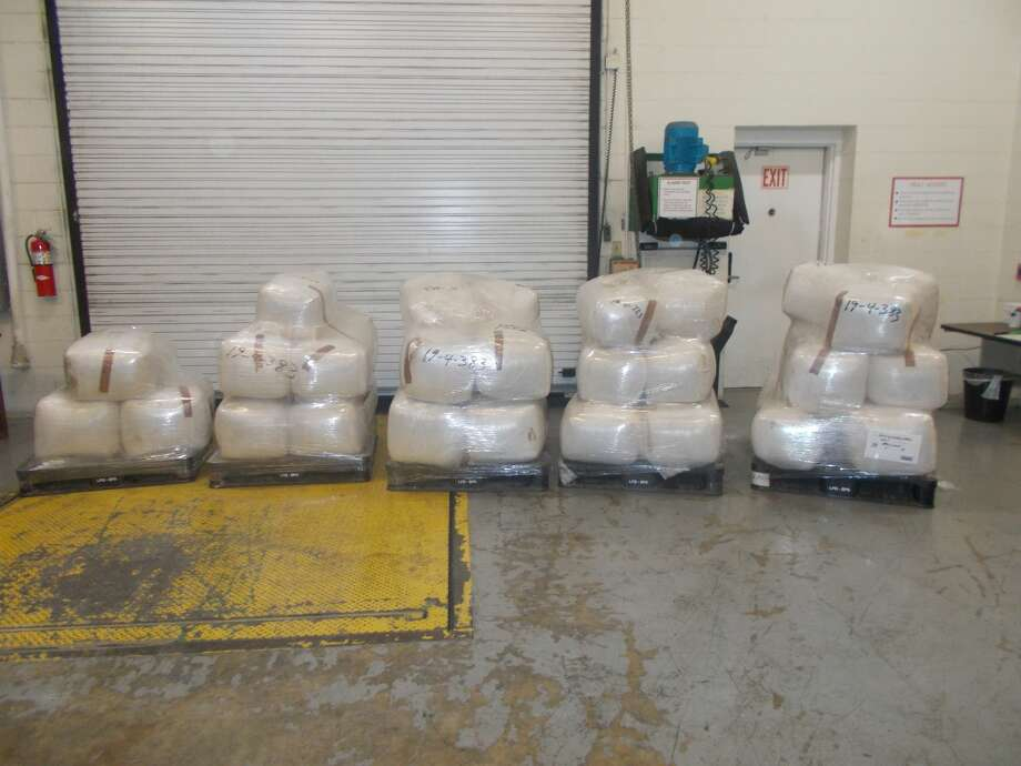 Shown are the 67 packages containing a total of 1,756 pounds of alleged marijuana discovered by CBP officers at the World Trade Bridge. Photo: Courtesy