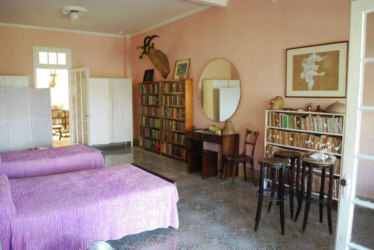 The master bedroom at Finca Vigia, outside Havana, where Hemingway lived until 1959. Now known as Museo Ernest Hemingway, the house remains a popular draw for tourists from around the world. All the objects on display, including some 9,000 books, belonged to the writer, who died in 1961.