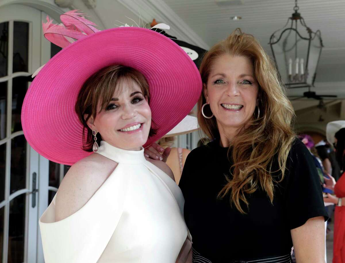 """Hallie Vanderhider and Paige Fertitta at the annual """"Hats Hearts and Horsehsoes"""" Kentucky Derby party benefiting Bo's Place hosted by Fertitta family Saturday, May. 4, 2019 in Houston, TX."""