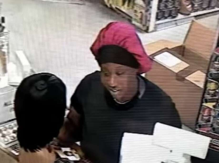 The suspect, a 30 to 40-year-old black woman, can be seen on surveillance video at Jades Beauty Supply located off 1449 Wilcrest allegedly shoplifting a wig. Photo: Houston Police Department