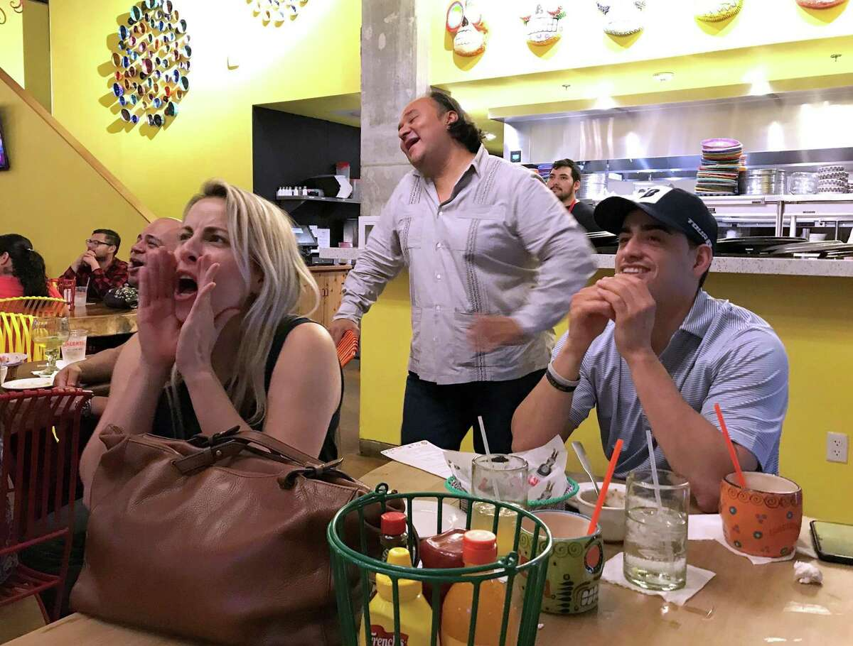 Johnny Hernandez (center) reacts as supporters boo during a May 5 viewing party celebrating Hernandez's losing appearance on the Food Network show 'Beat Bobby Flay.'