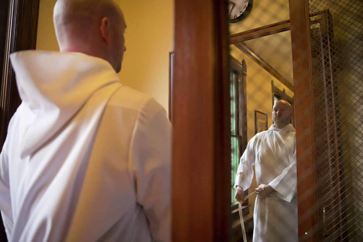Eric Brown puts on his robe in the new vesting area at Christ Church Cathedral on Sunday, April 7, 2019, in downtown Houston. The cathedral is nearing the end of a major renovation.