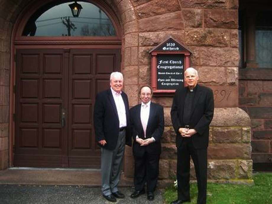 From left, First Selectman Mike Tetreau and Holocaust Commemoration Co-Chairs George Markley and Rev. Charles H. Allen, S.J., Fairfield University Chaplain and Special Assistant to the President, standing outside First Church Congregational where the 2019 Holocaust Commemoration will take place. Photo: Contributed Photo