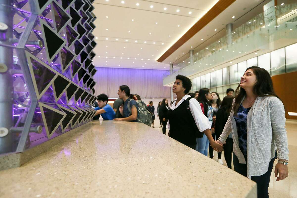 Alyssa Castro, right, and Victoria Coronado, with the Memorial High School hospitality and tourism class, gaze at the Liquid Crystal motiion activated sculpture during the group's tour of the Convention Center on Wednesday, May 1, 2019. Memorial High School in the Edgewood ISD is the first in the city to have a hospitality course program approved by TEA and the Texas Workforce Commission.