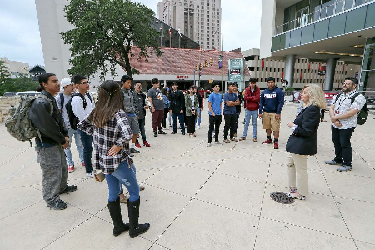Sherry Chaudhry, second from right, with Chaudhry Consulting, greets the Memorial High School hospitality and tourism class outside the Lila Cockrell Theatre before their tour of the Convention Center on Wednesday, May 1, 2019. Memorial High School in the Edgewood ISD is the first in the city to have a hospitality certification course program approved by TEA and the Texas Workforce Commission.