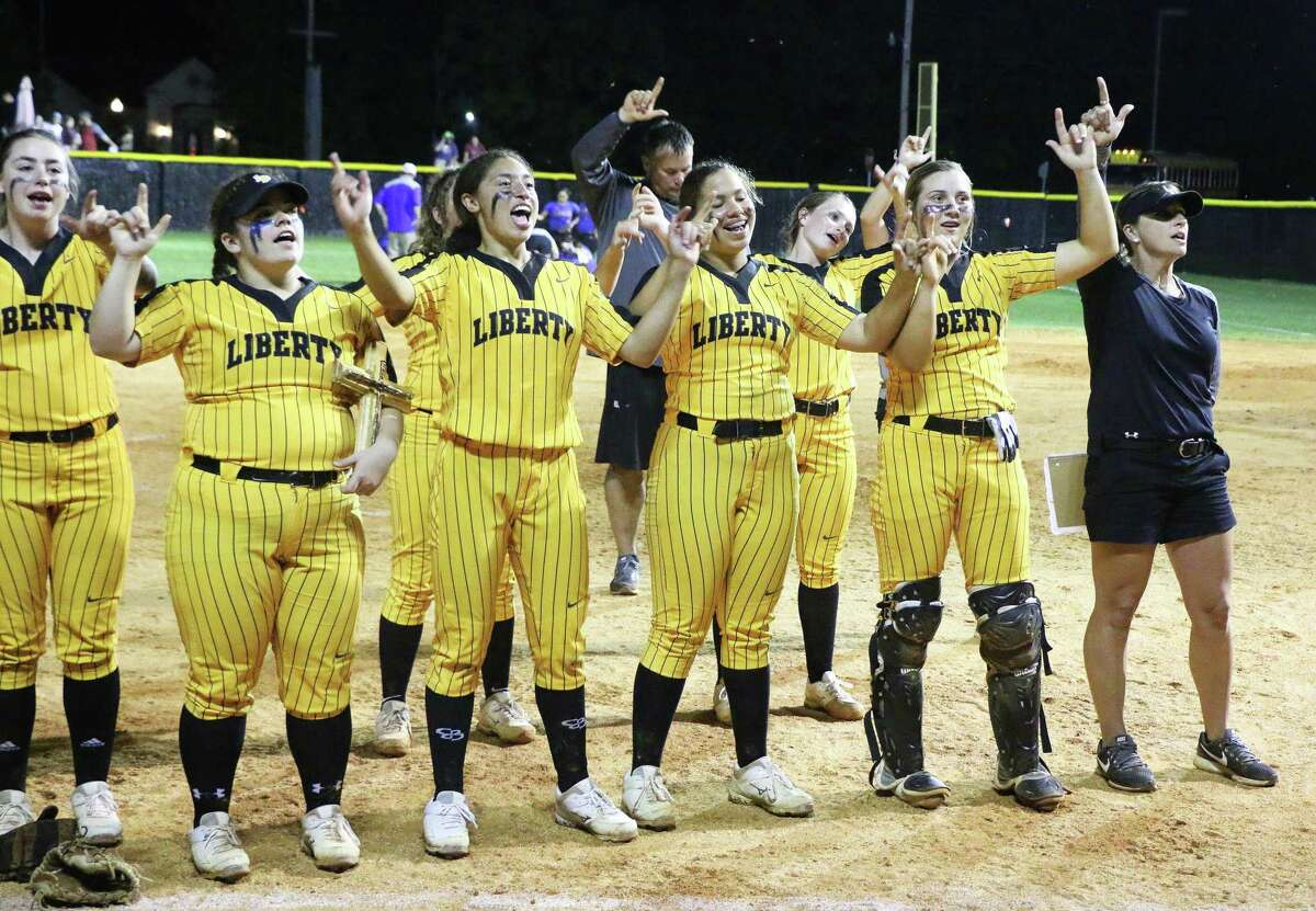 Lady Panthers celebrate following their two-game win over Bay City by singing the school song with their fans at homefield on the campus of Liberty High School.