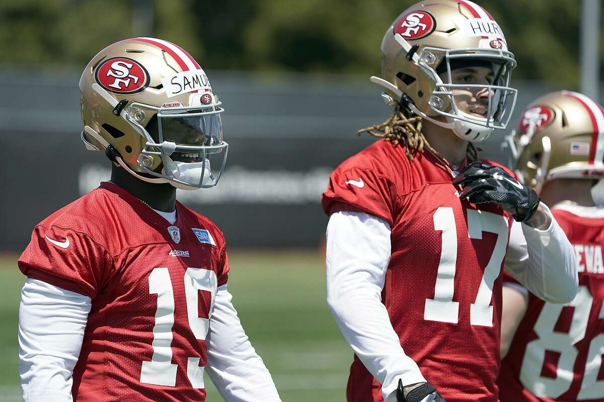 San Francisco 49ers rookie Deebo Samuel (19) and Jalen Hurd (17) work on a drill during the NFL football team's rookie minicamp in Santa Clara, Calif., Friday, May 3, 2019. (AP Photo/Tony Avelar)