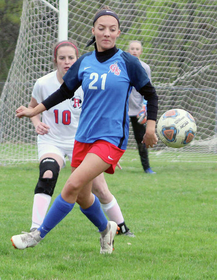 Skylar Nickel of Carlinville (21) eyes the ball with her back to the goal while being watched by Piper Martin of Roxana earlier this season at Loveless Park. Nickel has four goals and four assists as the Cavies enter regional play Wednesday against Southwestern Photo: Pete Hayes | The Telegraph
