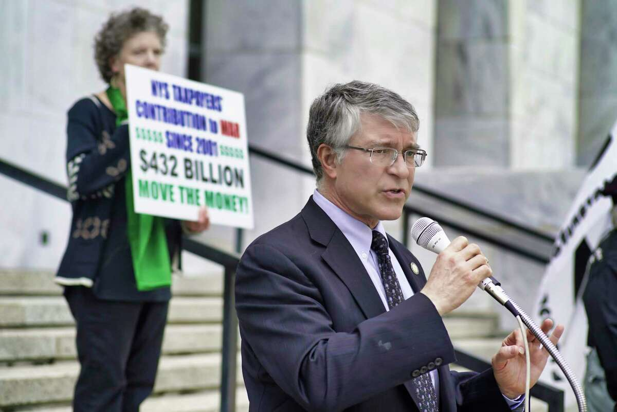 Assemblymember Phil Steck addresses those gathered on the steps of the Legislative Office Building for a rally put on by Women Against War on Monday, May 6, 2019, in Albany, N.Y. (Paul Buckowski/Times Union)