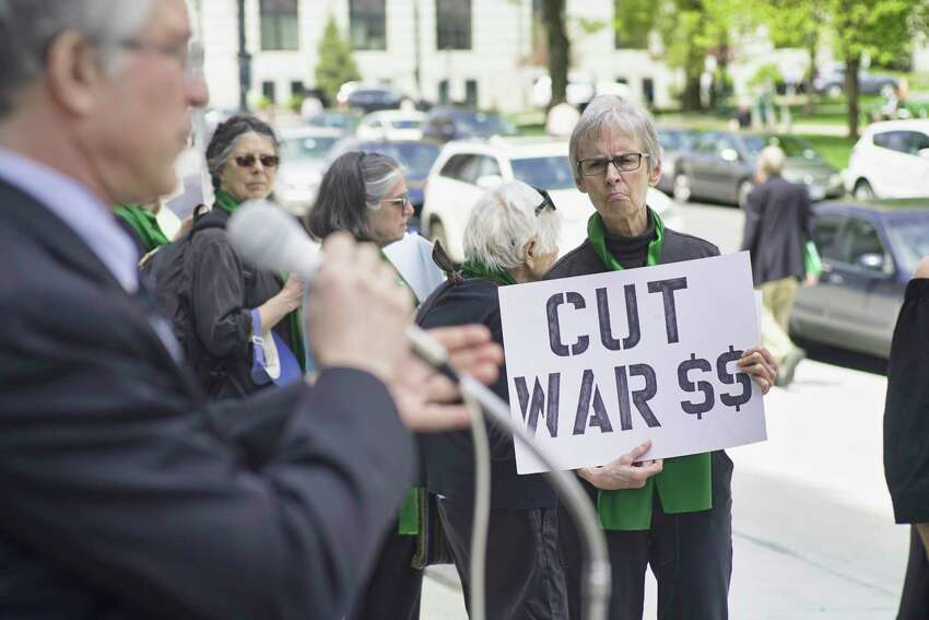 Marcia Hopple, a member of Women Against War, takes part in a rally on the steps of the Legislative Office Building on Monday, May 6, 2019, in Albany, N.Y. (Paul Buckowski/Times Union)