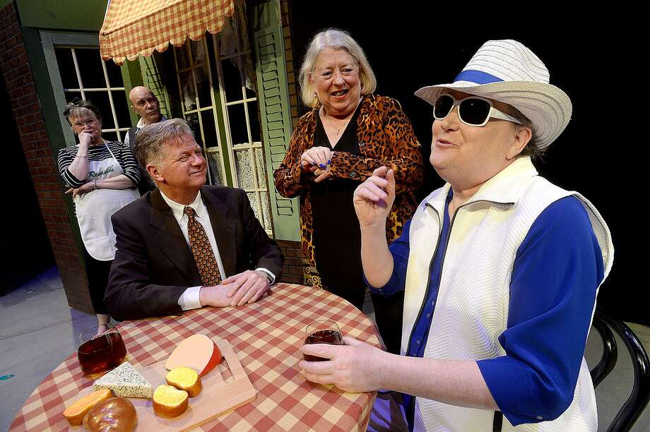 From left, James Jackson, Charlene Hudgins and Sean McBride run through a scene during Beaumont Community Players' taped rehearsal for their upcoming production La Cage Aux Folles onstage at the Betty Greenberg Center for Performing Arts. The play opens May 10 and runs through the 25th. Photo taken Wednesday, May 1, 2019 Kim Brent/The Enterprise Photo: Kim Brent / The Enterprise / BEN