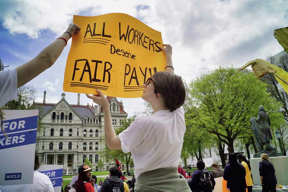 Luna Furtwangler, a student from Rondout Valley High School, holds up a sign in support of farmworkers during a rally outside the Capitol on Monday, May 6, 2019, in Albany, N.Y. A group of students from a racism classism and sexism class and from the Human Rights Club came up to take part in the rally. Those attending the rally were calling on the legislature to pass the the Farmworker Fair Labor Practices Act.  (Paul Buckowski/Times Union) Photo: Paul Buckowski, Albany Times Union / (Paul Buckowski/Times Union)