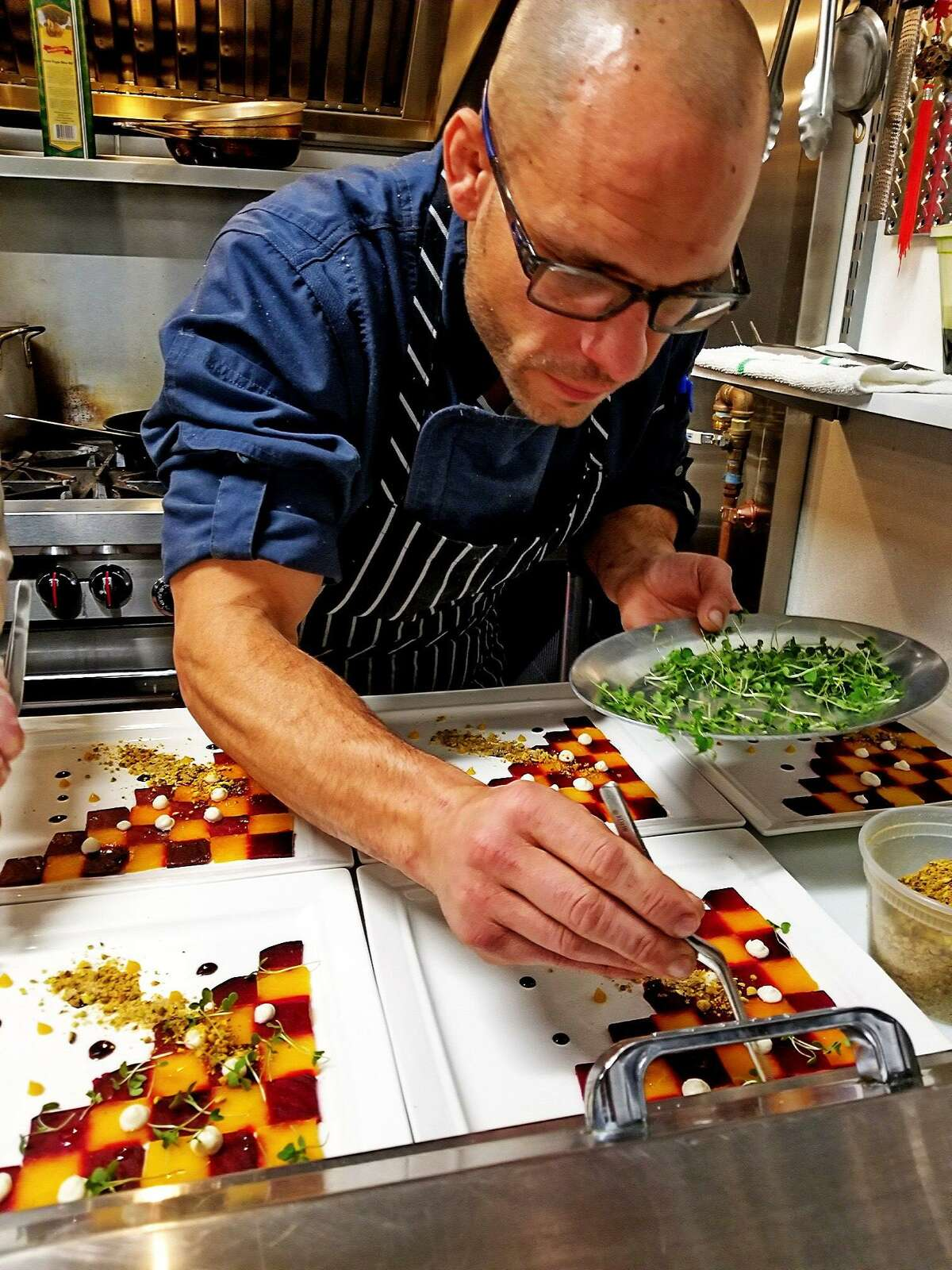 Chef/owner Carl Ciarcia Jr. carefully arranges a plate at Bread & Water restaurant at 51 Warwick St. in Middletown. He closed the eatery mid-April, after being unable to fully recover from the April 2017 blaze that destroyed much of the interior.