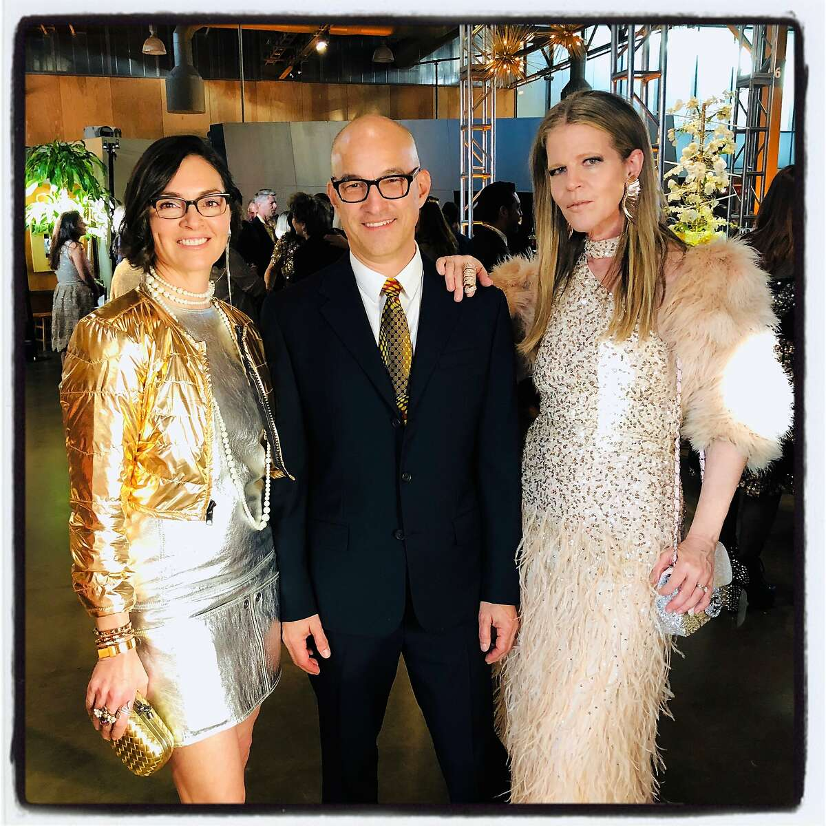 Claudia Cisneros (left) with her husband, Eric McDougal and Yvonne Force Villareal at the Exploratorium's Alchemy gala. May 3, 2019.
