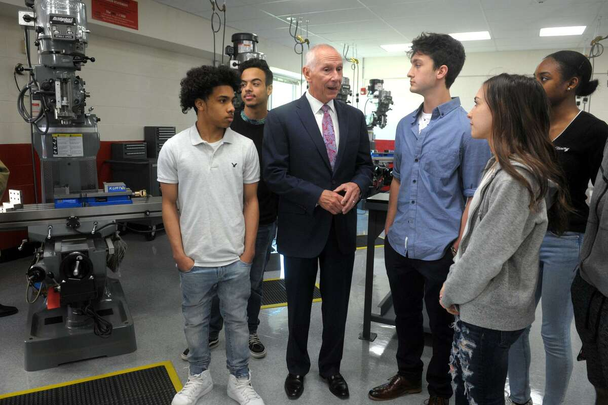 Mark Ojakian, President of Connecticut State Colleges and Universities, speaks with students following the ribbon cutting ceremony for the new Advanced Manufacturing and Technology Center at Derby High School, in Derby, Conn. May 6, 2019.