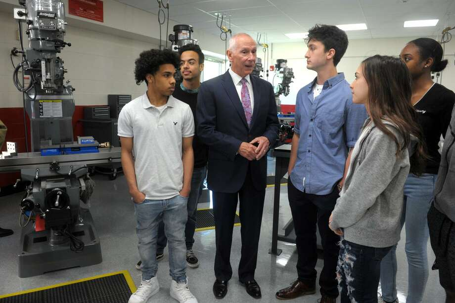 Mark Ojakian, President of Connecticut State Colleges and Universities, speaks with students following the ribbon cutting ceremony for the new Advanced Manufacturing and Technology Center at Derby High School, in Derby, Conn. May 6, 2019. Photo: Ned Gerard / Hearst Connecticut Media / Connecticut Post