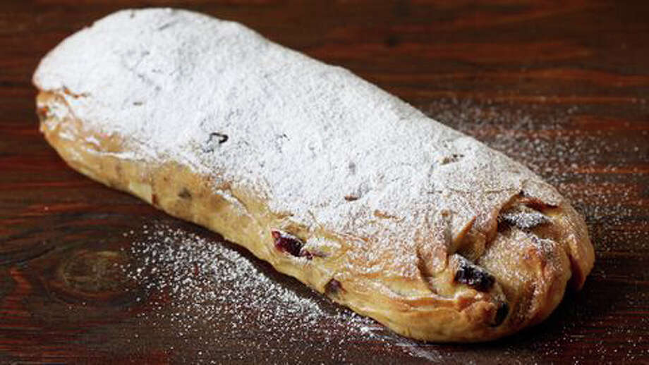 Stollen bread was reportedly created around Dresden, Germany in 1329. Despite its inclusion of raisins, citron and butter, stollen apparently assumed a more ascetic persona during Lent, the 40 days when Christians may fast or make other sacrifices. During Lent, bakers, it seems, were required to use only flour, oats and water to make stollen. But as the treat became associated with the Christmas holidays, stollen reverted to its original form as a yeasted bread laced with candied fruit and spices. Photo: Photo By Deb Lindsey For The Washington Post. / For The Washington Post