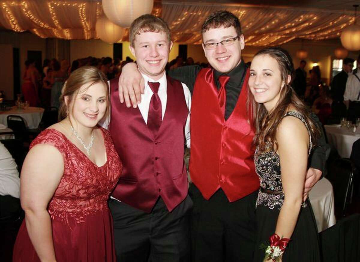From left, Rebecca Zurek, Jason Smalley, Brent Peruski and Haylie Essenmacher take a break from dancing Saturday night to flash a smile for the camera. Thestudents were dressed to impress for Ubly's prom celebration. For more photos of the night, see Page 8A. (Coulter Mitchell/For the Tribune)