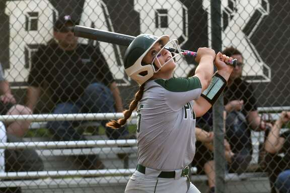 Kingwood Park second baseman Hannah Wilburn follows the flight of her pop-up against Willis in the bottom of the fourth inning of their District 20-5A matchup at KPHS on April 16, 2019.