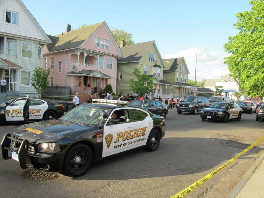 Several Bridgeport, Conn. police cruisers on Thursday, May 10, 2012. Photo: Tom Cleary / Tom Cleary / Connecticut Post