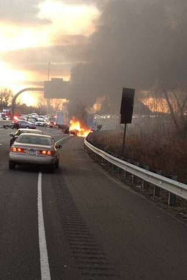 A police chase that began in New Haven ended with a fiery crash on I-95 in East Haven that injured three people on Thursday, Jan. 5, 2011. Photo: WTNH ReportIt / Contributed / Connecticut Post