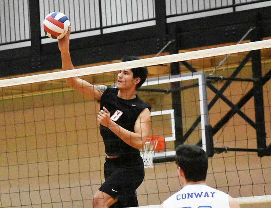 Eric Epenesa goes up for a kill during a volleyball match against Belleville East for Edwardsville inside Lucco-Jackson Gymnasium this season.
