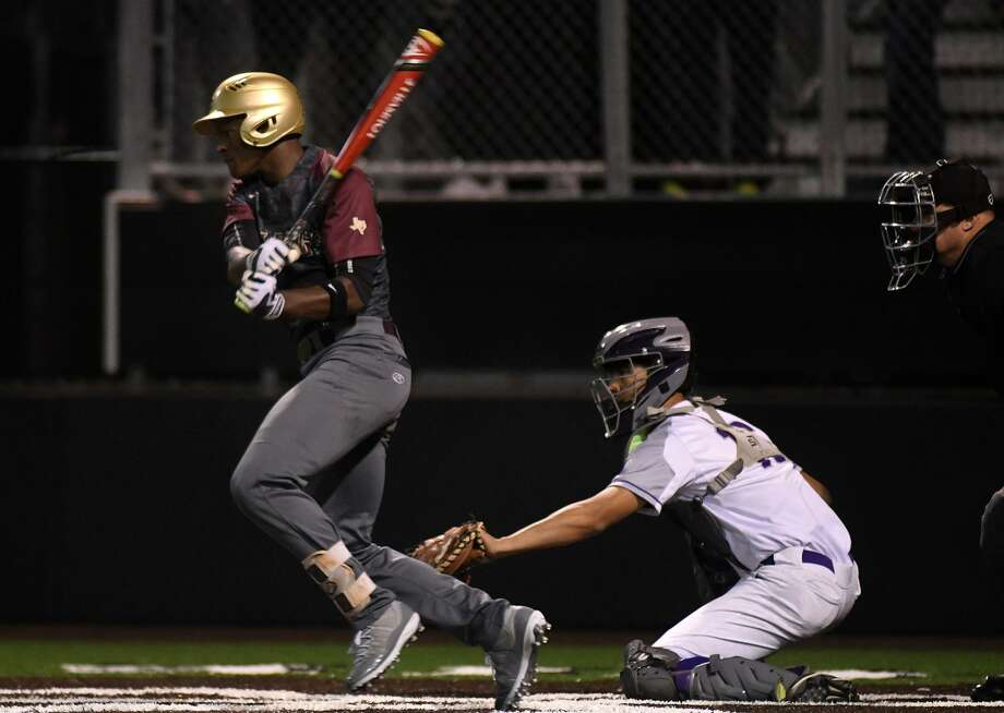 Summer Creek senior Tyler Via, left, drives a ball in front of Humble catcher Alex Mier-Salazar during the top of the 6th inning of their District 22-6A matchup at Humble High School on April 2, 2019. Photo: Jerry Baker, Houston Chronicle / Contributor / Houston Chronicle