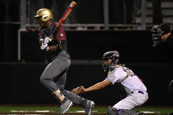 Summer Creek senior Tyler Via, left, drives a ball in front of Humble catcher Alex Mier-Salazar during the top of the 6th inning of their District 22-6A matchup at Humble High School on April 2, 2019.