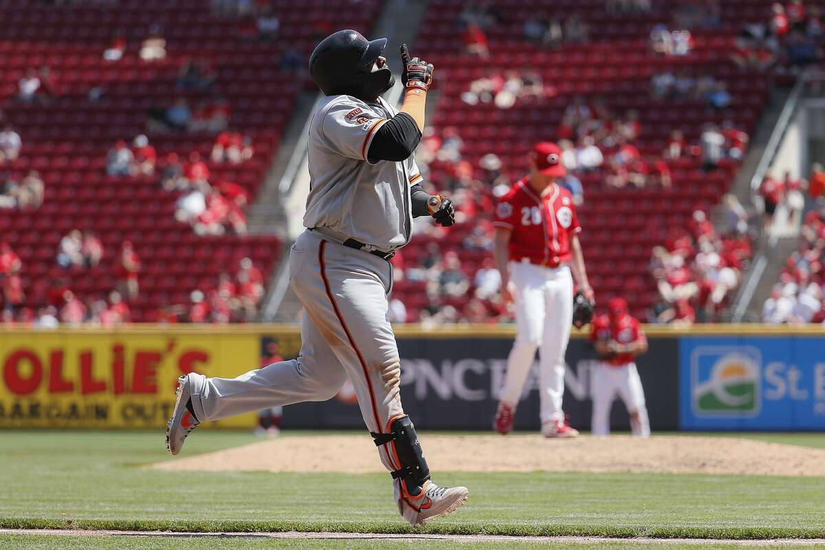 San Francisco Giants' Pablo Sandoval runs the bases after hitting a three-run home run off Cincinnati Reds starting pitcher Anthony DeSclafani in the sixth inning of a baseball game, Monday, May 6, 2019, in Cincinnati. (AP Photo/John Minchillo)