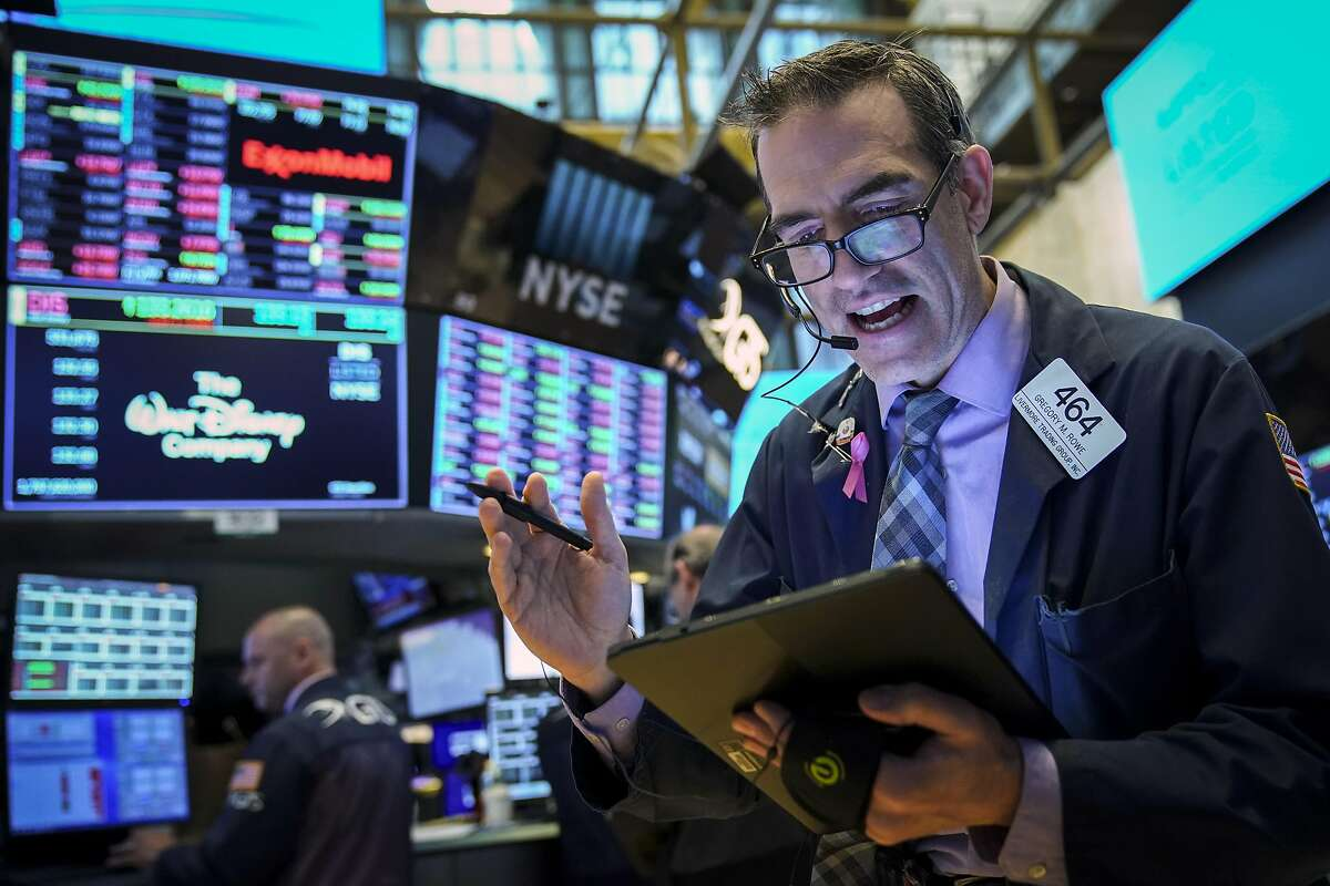 NEW YORK, NY - MAY 6: Traders and financial professionals work at the opening bell on the floor of the New York Stock Exchange (NYSE), May 6, 2019 in New York City. The Dow Jones Industrial Average dropped over 360 points at the open on Monday morning after U.S. President Donald Trump said that the U.S. will raise tariffs on goods imported from China. China also threatened to skip upcoming trade talks following tariff threats from President Trump. (Photo by Drew Angerer/Getty Images) *** BESTPIX ***