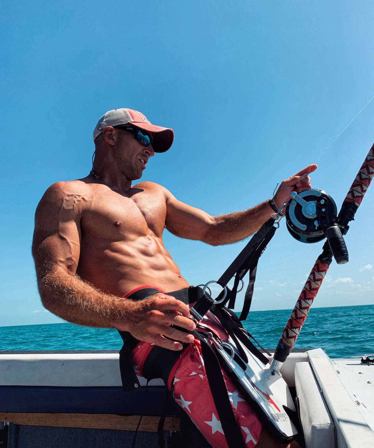 Sudal said he decided to throw out one last bonita fish as bait and within five minutes caught a tiger shark near the shore in Captiva Island, Florida. (Photo by@acksharks)