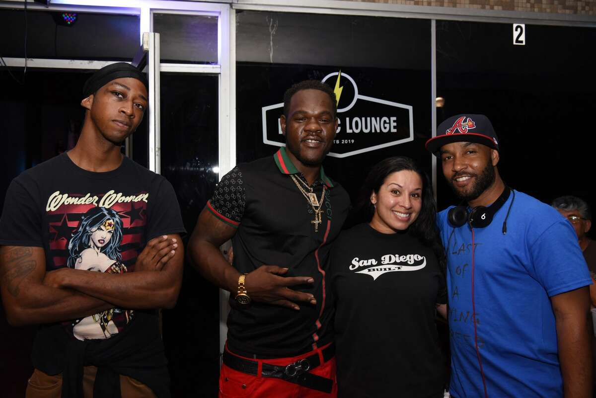 Matthew Descovia, OG BIGHOMIE$avage, Alma Acevedo and Waytooreal Mentality pose for a photo during the Cinco De Mayo Fest at Electric Lounge, Sunday, May 5, 2019.