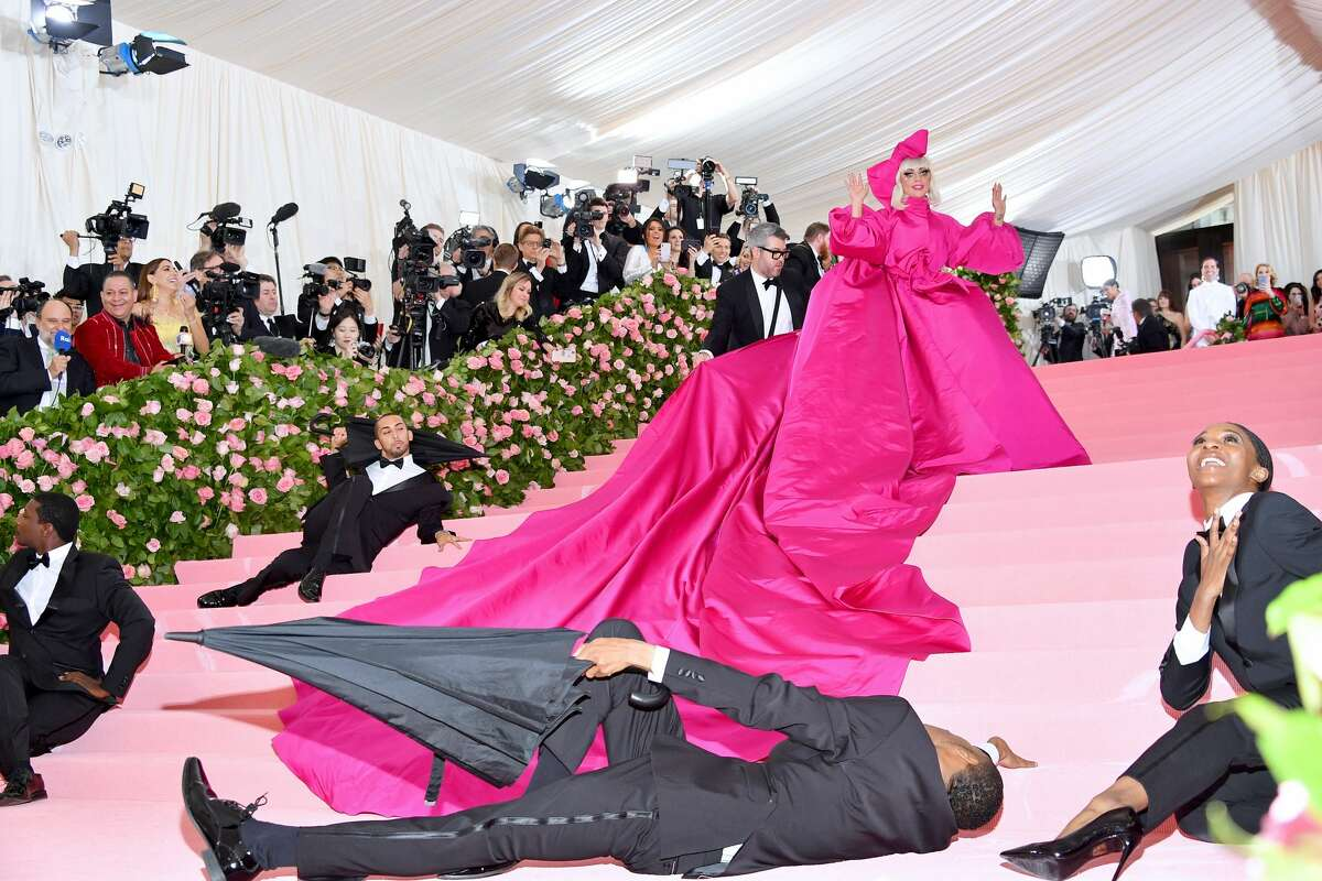 Lady Gaga (and her umbrella-toting entourage) attends The 2019 Met Gala Celebrating Camp: Notes on Fashion at Metropolitan Museum of Art on May 06, 2019 in New York City.