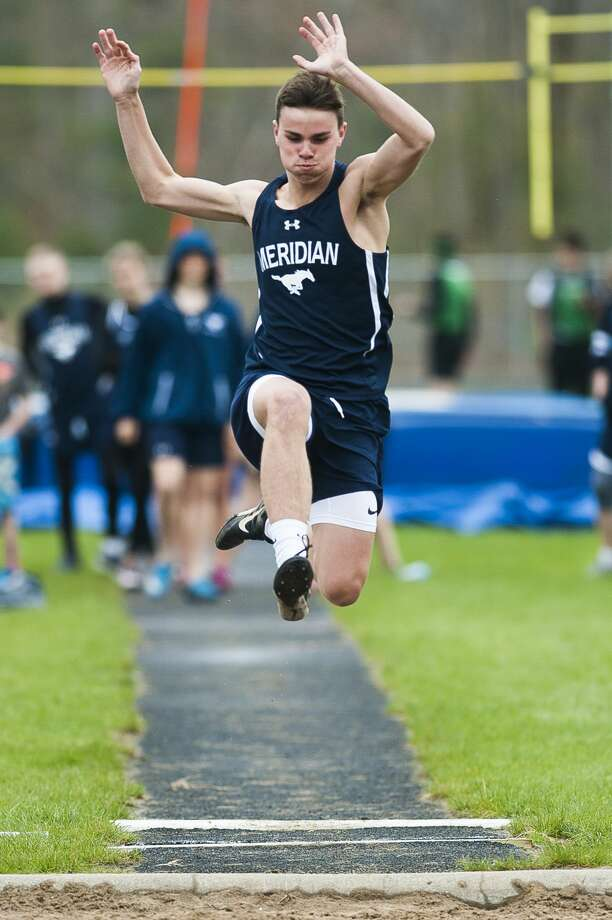 Meridian's Cameron Metzger competes in the long jump during a meet against Houghton Lake on Monday, May 6, 2019 at Meridian Early College High School. (Katy Kildee/kkildee@mdn.net) Photo: (Katy Kildee/kkildee@mdn.net)