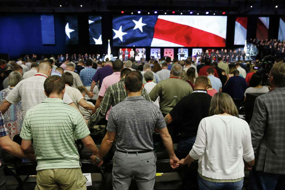 People pray for America in June at the 2018 Annual Meeting of the Southern Baptist Convention at the Kay Bailey Hutchison Dallas Convention Center in Dallas. The decision to tackle sexual abuse in SBC churches at upcoming regional and national meetings is a welcome move.