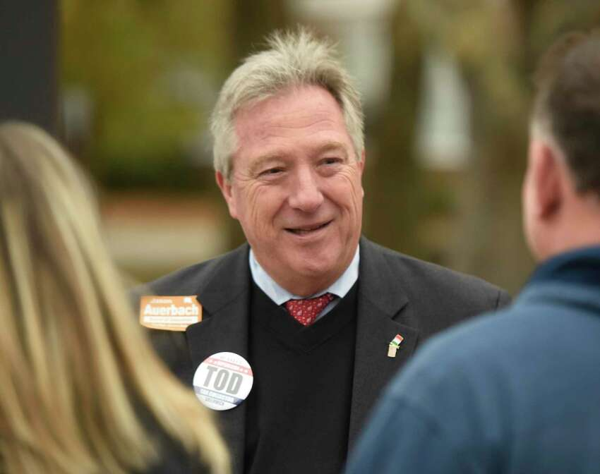 Republican Tax Collector Tod Laudonia chats outside North Mianus School, the District 12 polling center, on Election Day in Greenwich, Conn. Tuesday, Nov. 7, 2017.