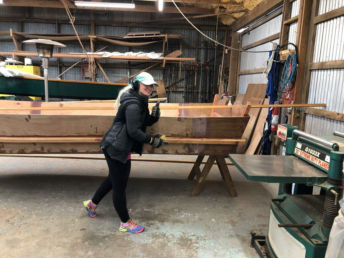 Jaselyn Blanchard-Pace helps her husband Mason Pace build the 18-foot Port Aransas skiff the family constructed at Farley Boat Works.