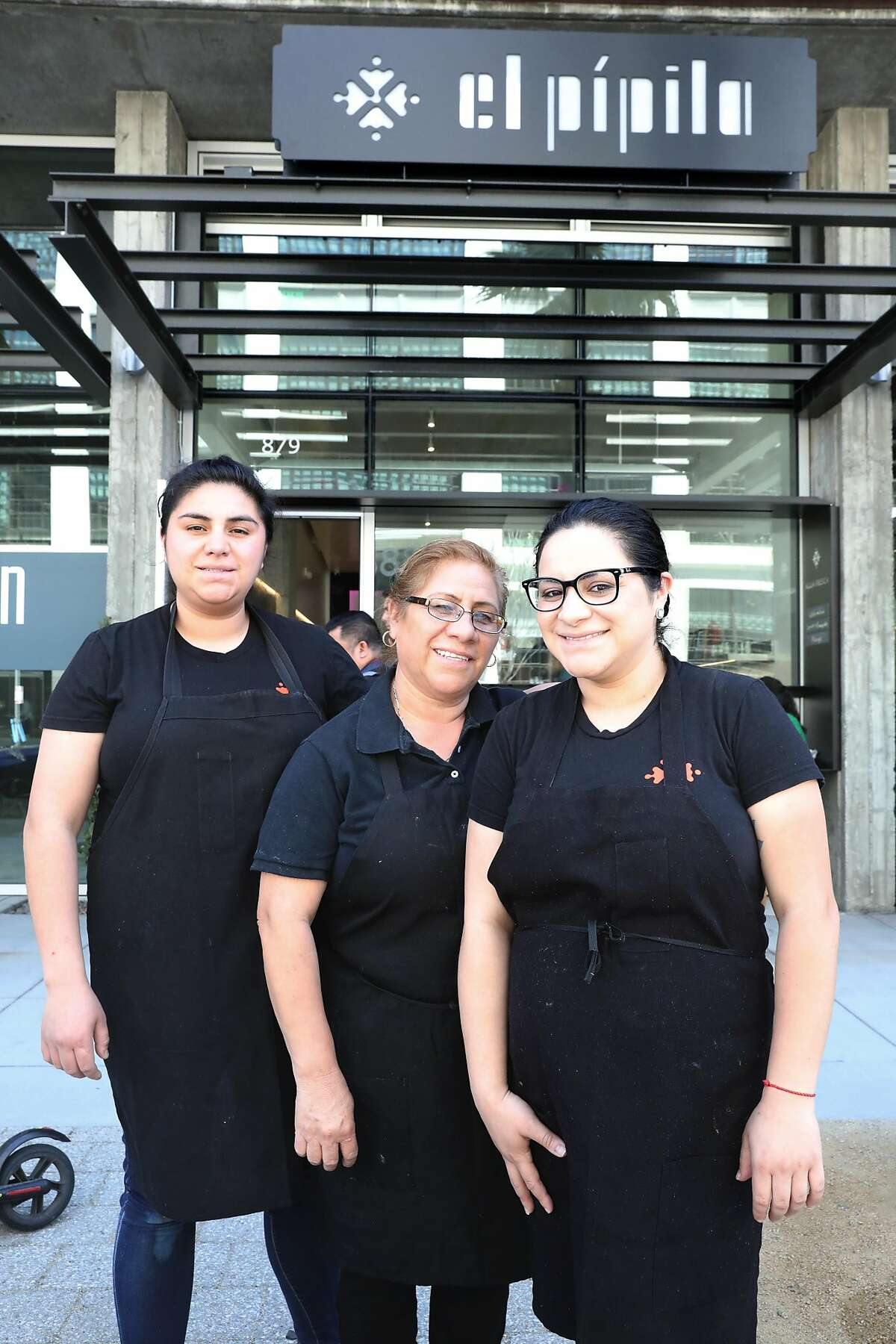 Guadalupe Guerrero (middle) with her daughters Alejandra Juarez (left) and Brenda Juarez (right) in front of El Pipila, a Guanajuato restaurant seen on Tuesday, April 23, 2019, in San Francisco, Calif.