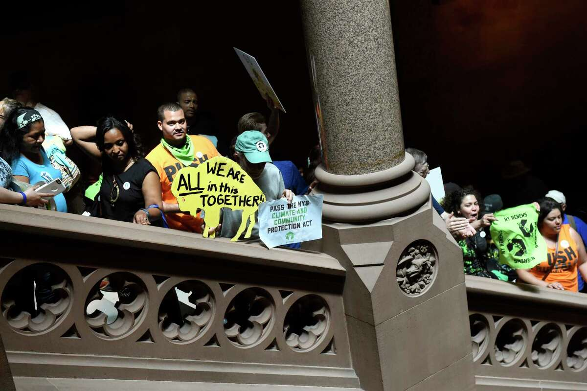 Environmental justice communities line the Senate Staircase as they call on the legislature to pass the NYS Climate and Community Protection Act on Wednesday, June 1, 2016, at the Capitol in Albany, N.Y. (Cindy Schultz / Times Union)