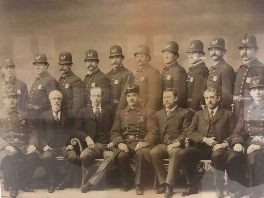 The Stamford Police Department in 1900, six years after the department was founded in 1894. Mayor Homer Cummings is sitting next to Chief George Bowman wearing chief's cap in the front row. Photo: Courtesy Stamford Police