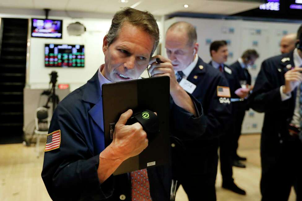 FILE - In this May 1, 2019, file photo, trader Robert Charmak, left, works on the floor of the New York Stock Exchange. On Monday, May 6, U.S. stocks plunged at the opening of trading, following a sell-off in global markets, after President Donald Trump threatened to escalate a trade war between the world?s two largest economies. (AP Photo/Richard Drew, File)
